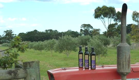 Devon Siding Olive Oil bottles on a tractor